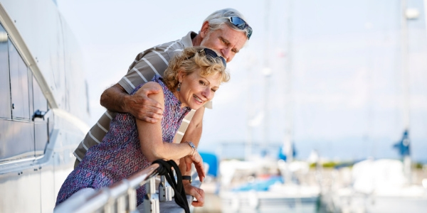 senior couple smiling on boat trip