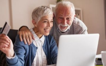 mature couple on computer online shopping