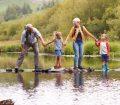 Grandparents and grandchildren crossing river