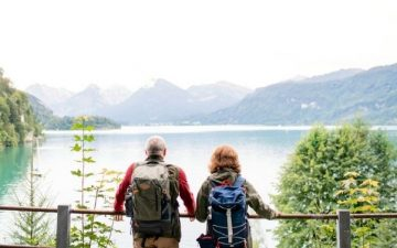 senior couple looking out over mounrtains