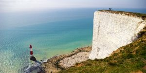 an image of a lighthouse just off the white cliffs of Dover
