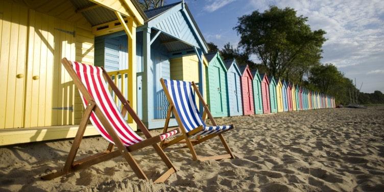 Stripey deckchairs on a beach