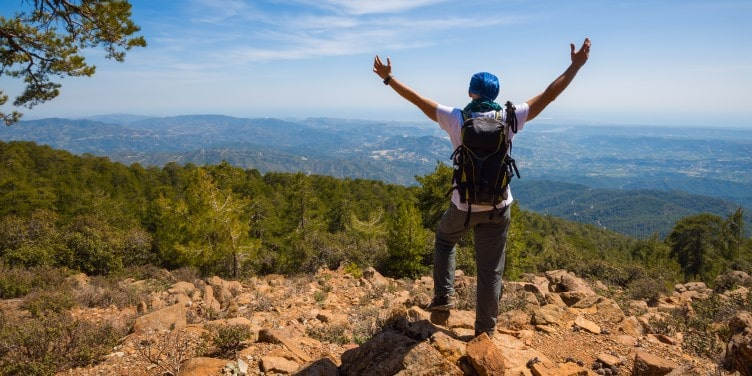 Traveller with open arms on Troodos Mountain