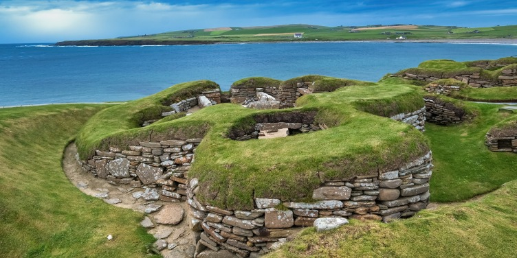 an image of Skara Brae, a Neolithic village in Orkney that's part of a World Heritage Site