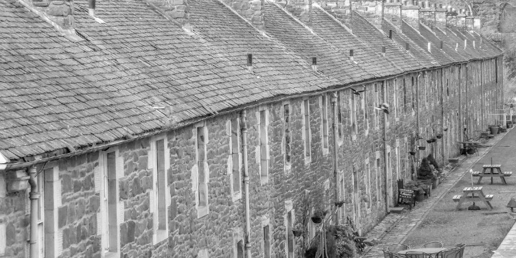an image of a row of mill workers' cottages in New Lanark, a World Heritage Site in Scotland
