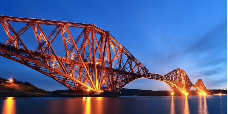 an image of the Forth Bridge, a World Heritage Site in Scotland, at night