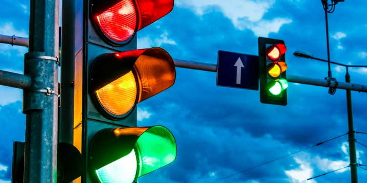 Traffic lights showing red, amber and green