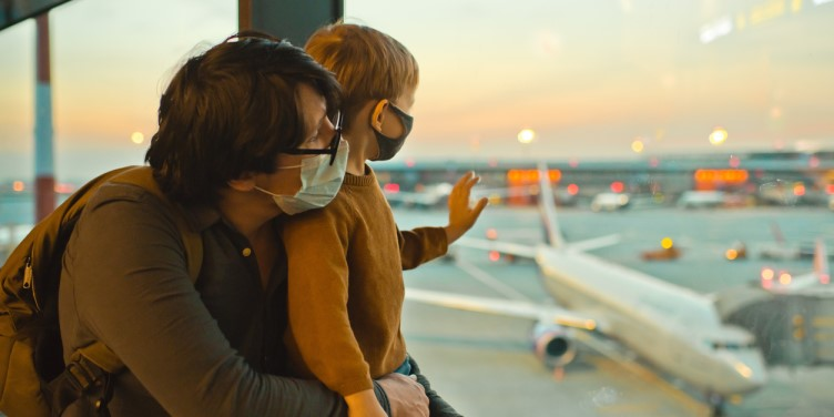 Father and son in airport