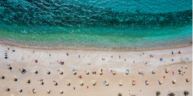 an image of a beach where visitors are practicing social distancing