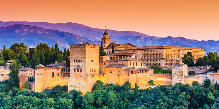 an image of Alhambra fortress in Granada, Spain at sunset