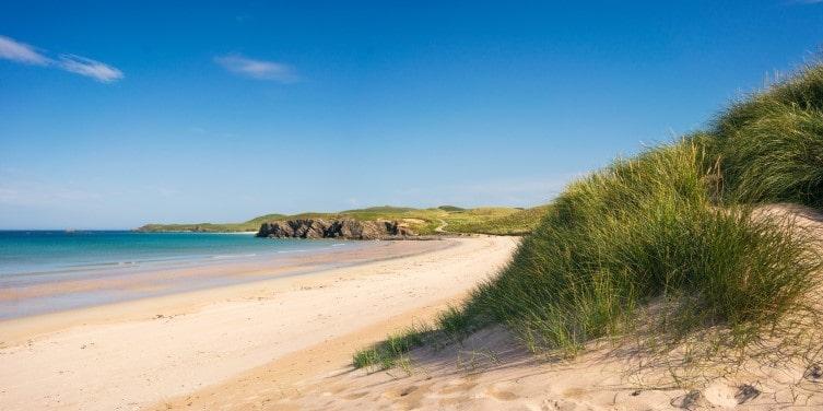 Sand dunes of Balnakeil Beach on a sunny day