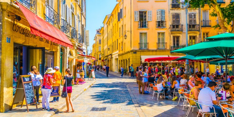 Tourists enjoying lunch in cafes lining the colourful streets of Aix-en-Provence