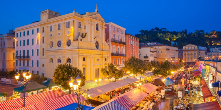 Nighttime shot of Nice's street cafes, restaurants and bars busy with tourists