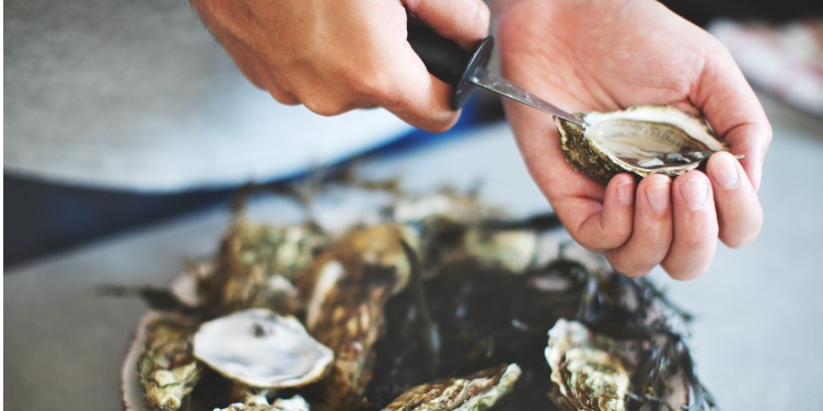 Oysters being prepared to eat