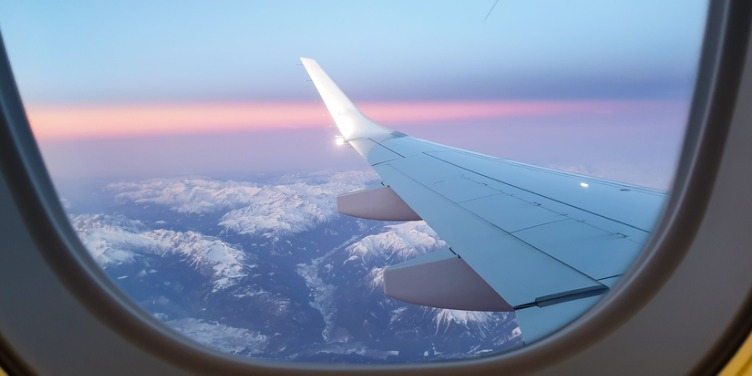 an image of mountains from the view of a plane window