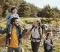 Family hiking through woods