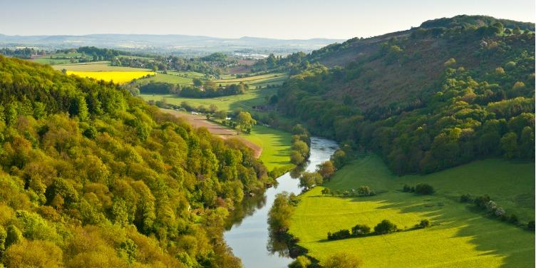 an image of a river running through rural England