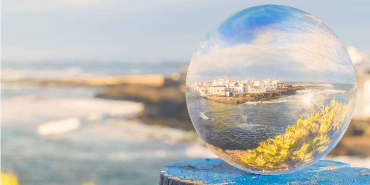Old fishing port of El Cotillo on Fuerteventura photographed through a glass ball